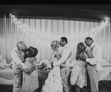 black and white photo of her wedding with multiple couples kissing