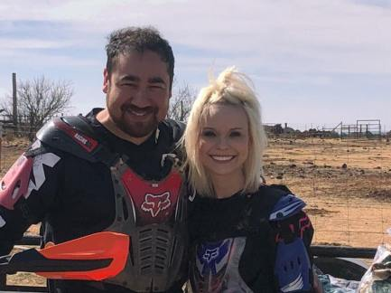 Shelby with her husband as they are in racing gear