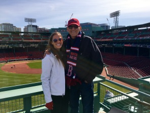 Issac and Shelby enjoying a Boston Red Sox baseball game.