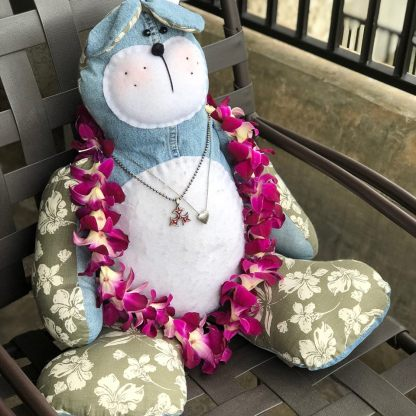A teddy bear made with Sean's shirt and pants with a Hawaiian lei as they took Sean Bear to Hawaii.