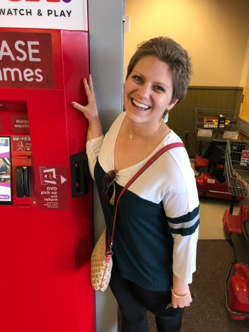 "Nicole standing by a Red Box ""petting it"" as a joke with a friend"