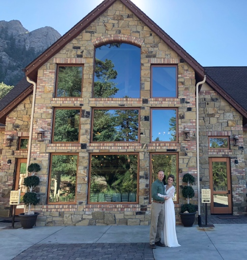 Wes and Nicole standing in front of the Della Terra Mountain Chateau getting ready to renew their vows.