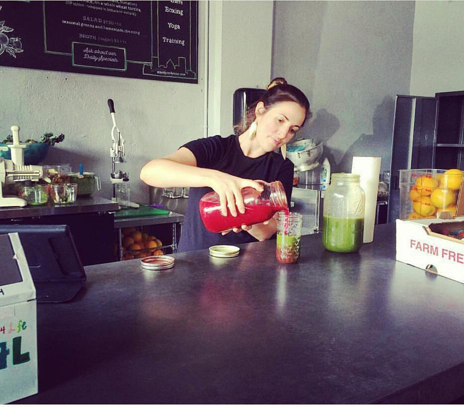 Sabrina pouring juice taking a holistic approach to fighting cancer.