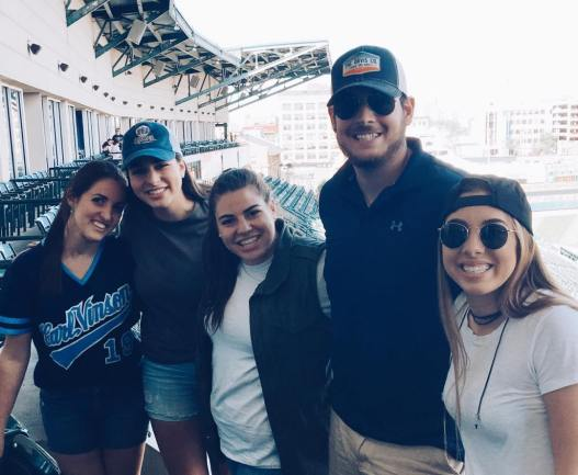 Photo of Sabrina with all of her siblings at a ballgame