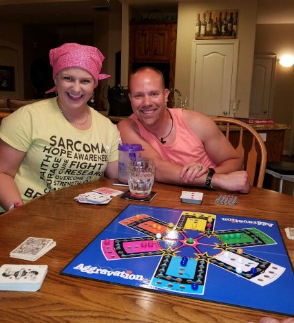 A picture of Wes and me playing Aggravation with my family.