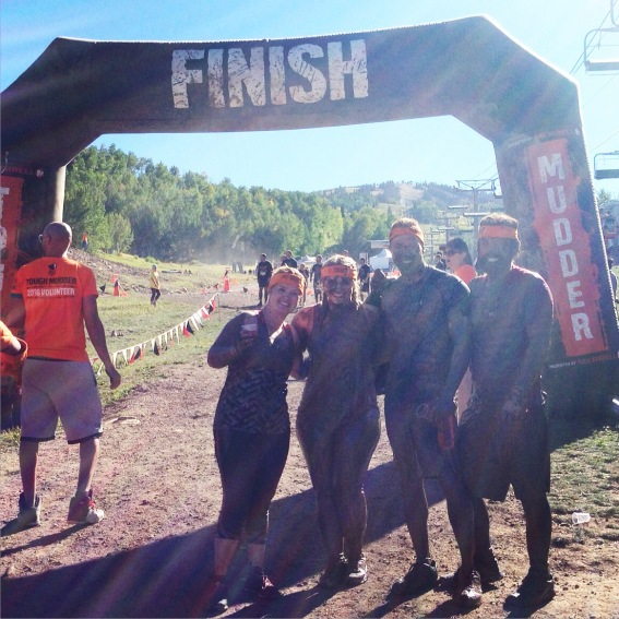 Kelsey, Nicole, Wes, and Jeffrey at the finish line of the Tough Mudder