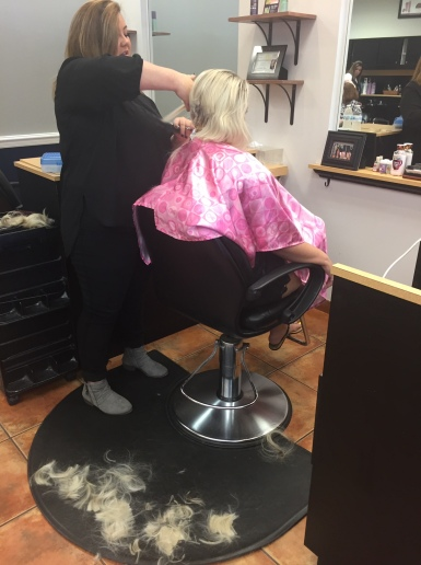 Nicole's hair being cut in chunks on the floor for chemo