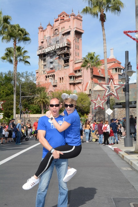 I jumped on Wes as we stand in front of the Hollywood Tower of Terror at Hollywood Studios at Disney World.