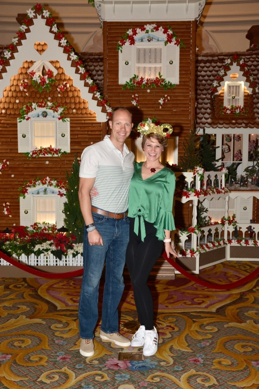 The lifesize gingerbread house at the Grand Floridian while Wes and I are dressed up in our Christmas Green!