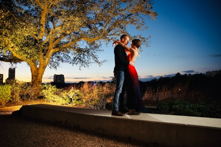 Wes and Nicole holding one another as the night falls. Photo by Quy Tran Photography
