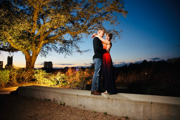 Wes holding Nicole as she smile as the camera as the sun has set. Photo by Quy Tran Photography