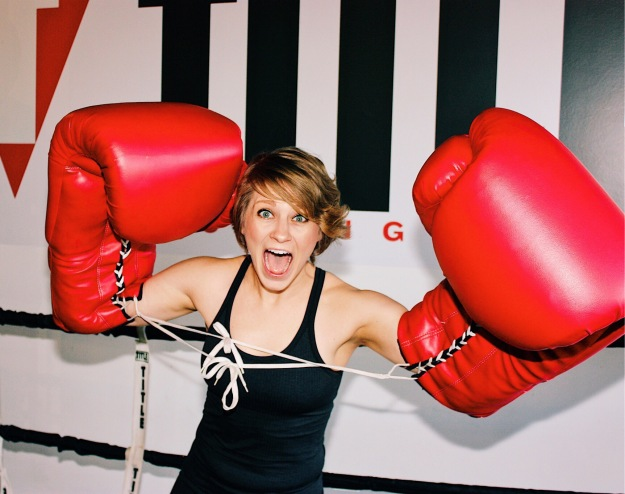Nicole being silly looking at the camera with giant boxing gloves on.