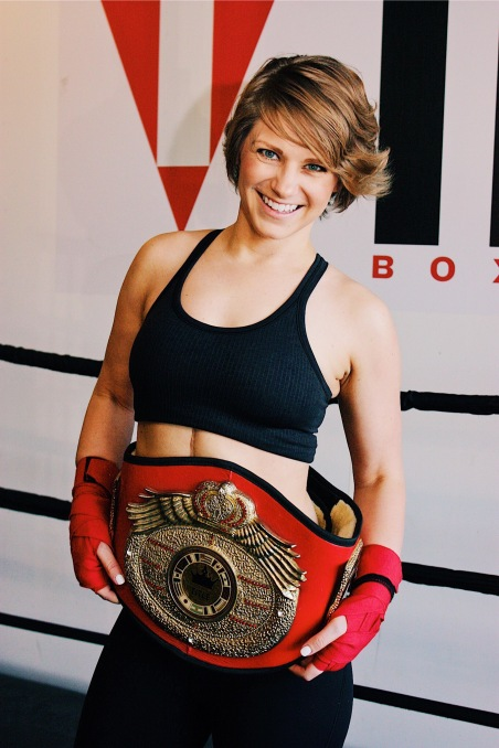 Nicole holding the title belt as she had just beaten her opponent!