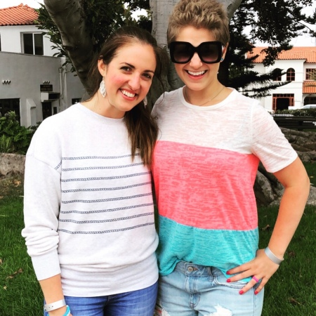 Nicole and Sabrina smiling for a photo in Carlsbad California.