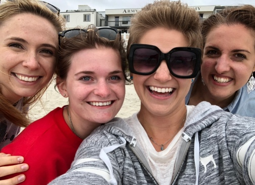 Maddie, Brooke, Nicole, and Sabrina taking a selfie on the beach in California.