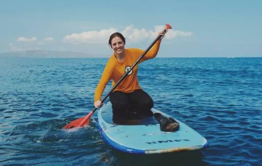 Sabrina paddleboarding in Hawaii
