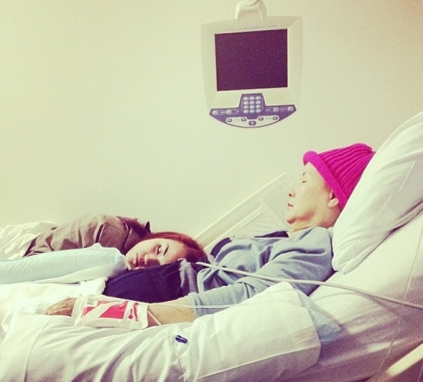 Sharon lying down next to her mother, Ruby, in a hospital bed