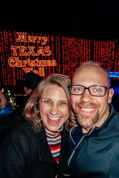 "Wes and Nicole at Santa's Wonderland taking a selfie with the ""Merry Texas Christmas Y'all"" Light Up Exhibit"