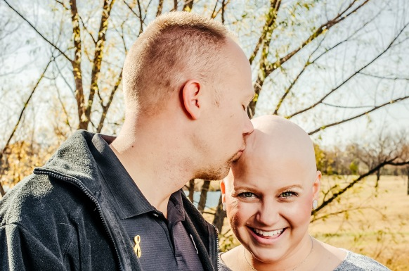Wes kissing my bald head on a fall day